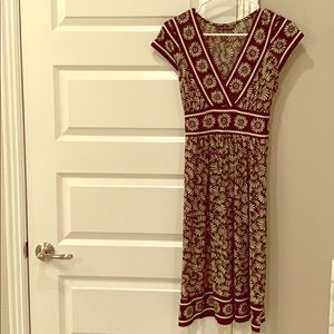 Brown and green cap sleeve dress. Knee length